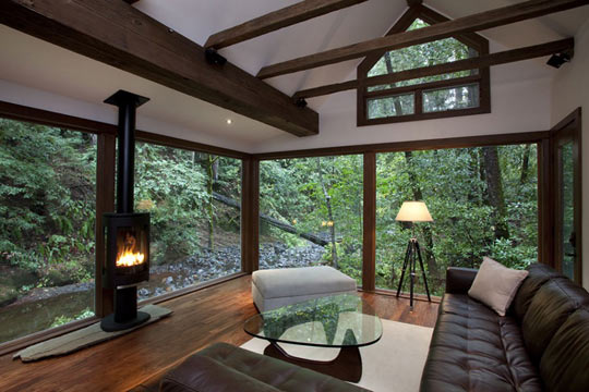 cool-glass-house-forest-window-fireplace