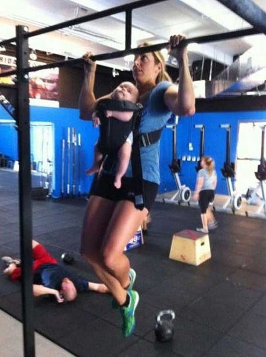 funny-mother-training-baby-pullup