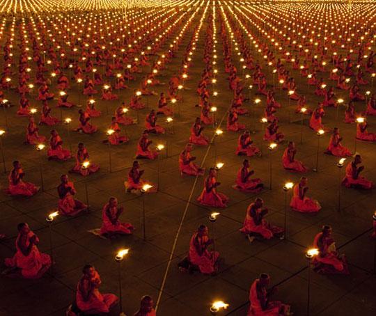 cool-monks-praying-candles-night