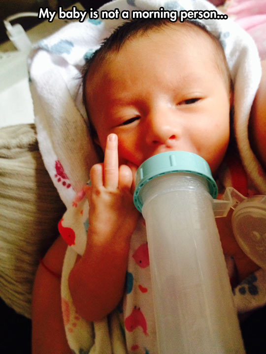 funny-baby-drinking-milk-middle-finger