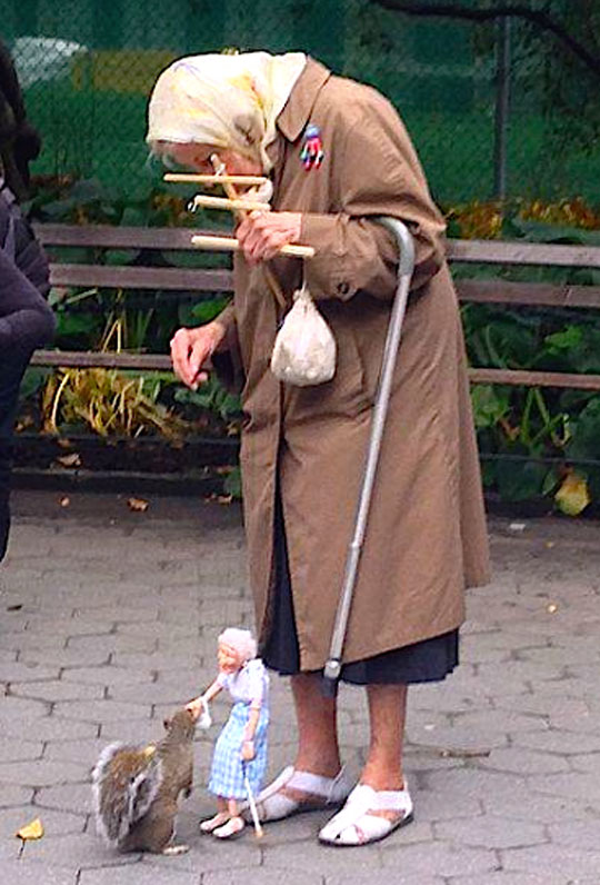 cute-old-woman-puppet-squirrel-park
