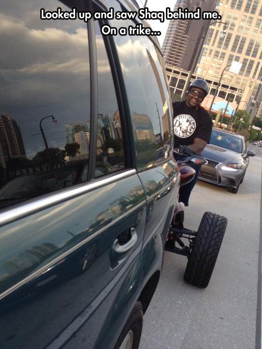 funny-Shaq-trike-highway-car-behind