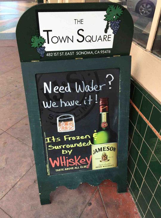 funny-bar-street-sign-frozen-water