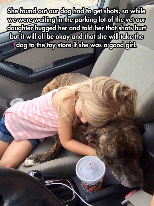cute-girl-hugging-dog-car