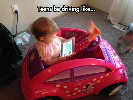 funny-kid-girl-iPad-car-toy