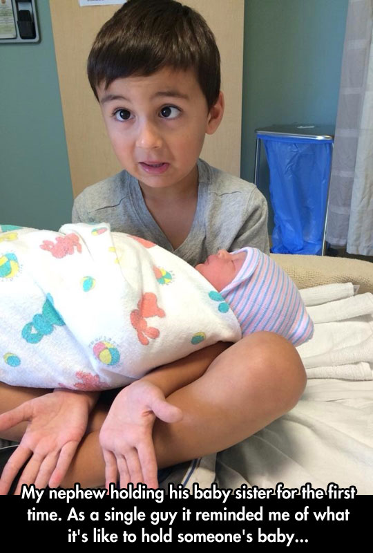 funny-kid-holding-baby-brother-hospital