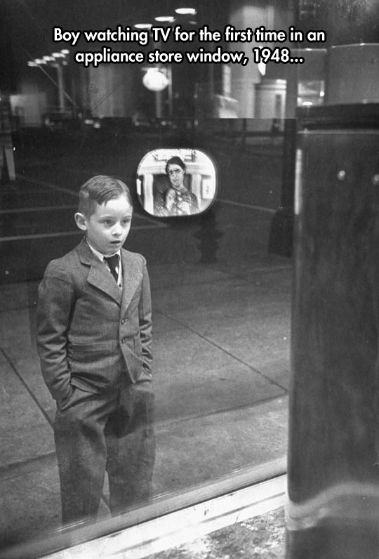 funny-kid-watching-TV-first-time-store