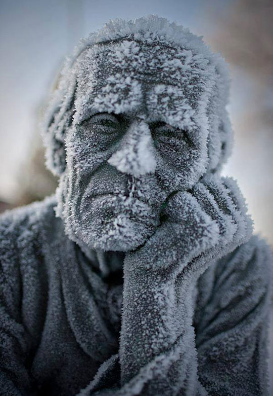 Frozen Old Statue