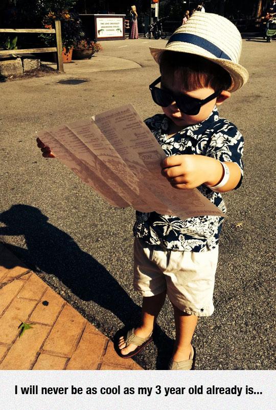 Classy Kid reading newspaper