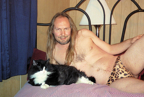 wtf_people_posing_with_animals_6