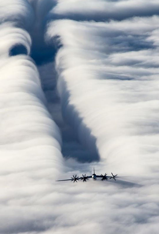 cool-plane-top-clouds-sky