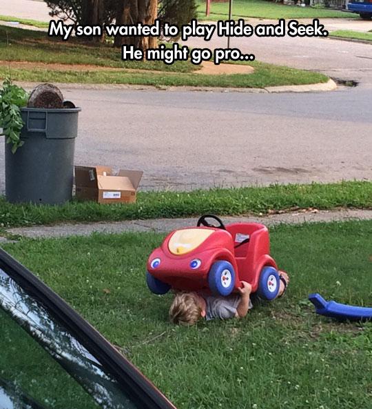 funny-kid-hiding-under-car-yard