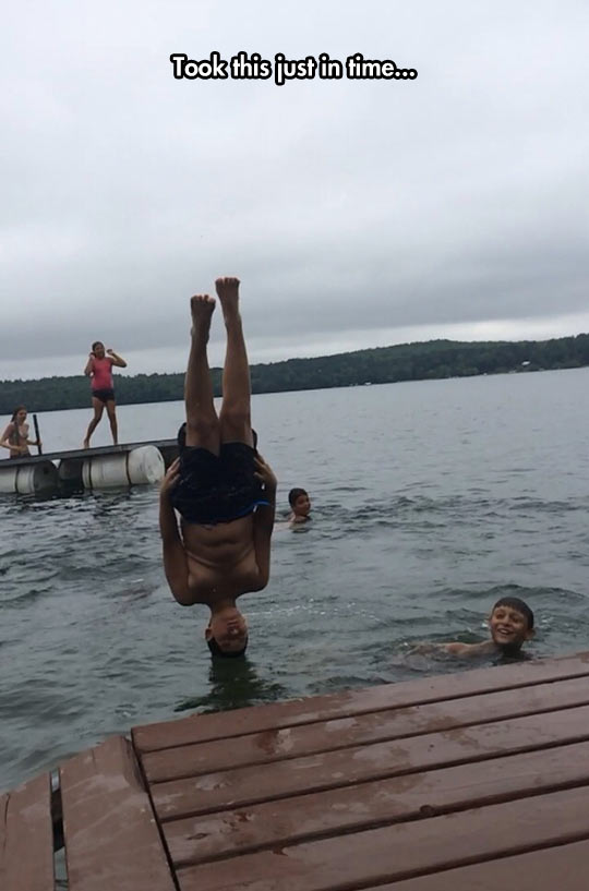 funny-kid-jump-water-head-over-lake