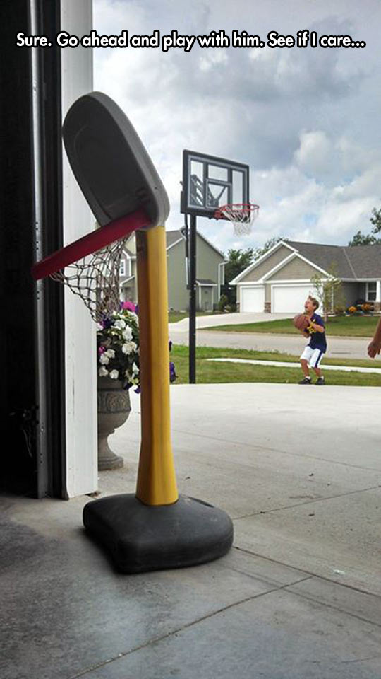 funny-kid-playing-basketball-ring