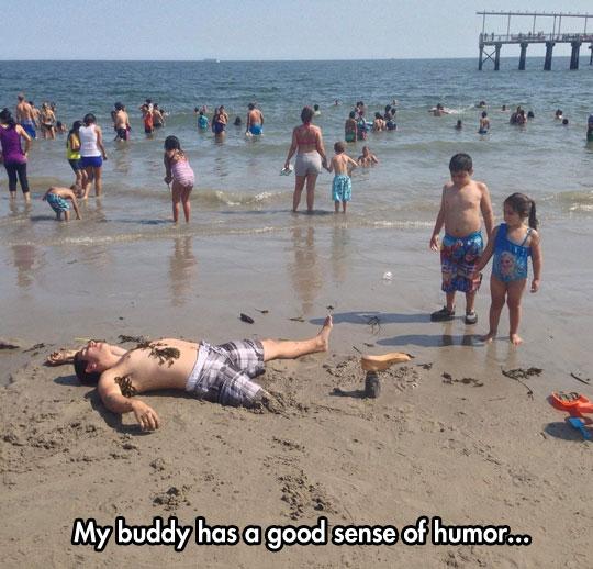 funny-man-lying-beach-wooden-leg