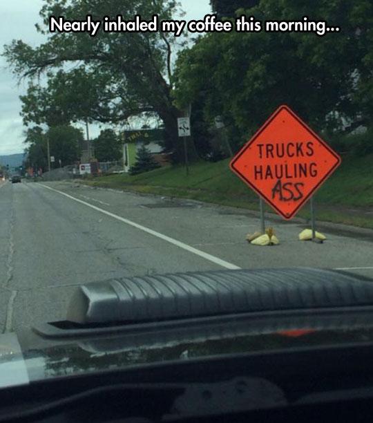 funny-road-sign-graffiti-trucks