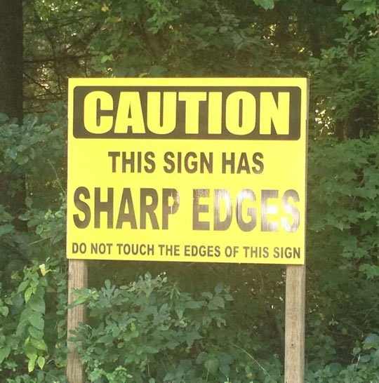 funny-sign-sharp-edges-caution