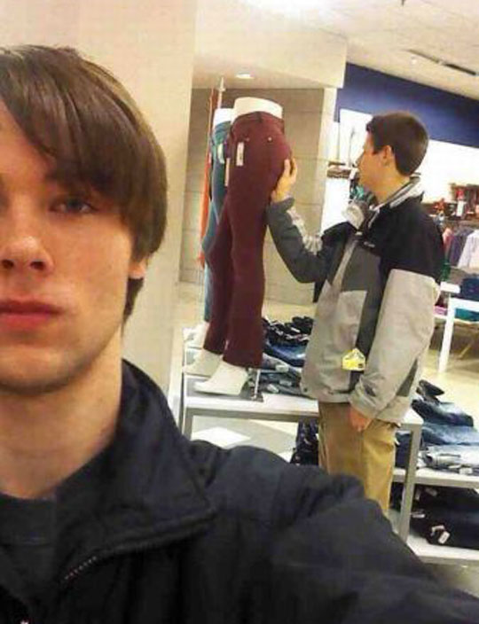 funny-teen-touching-mannequin-store