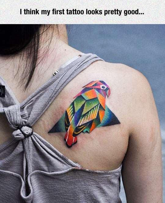 cool-girl-back-parrot-tattoo