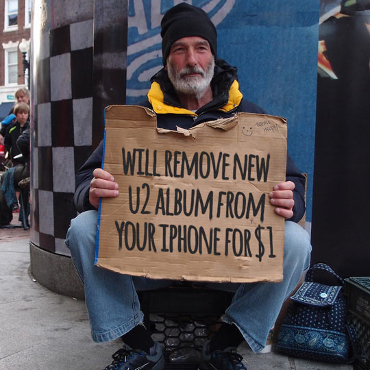 funny-homeless-remove-U2-album-sign