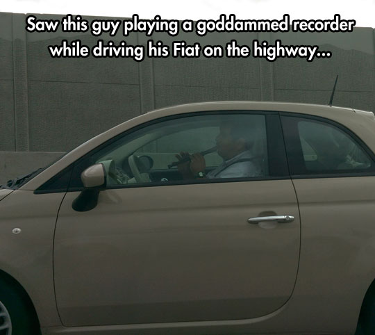 funny-man-driving-playing-flute-car