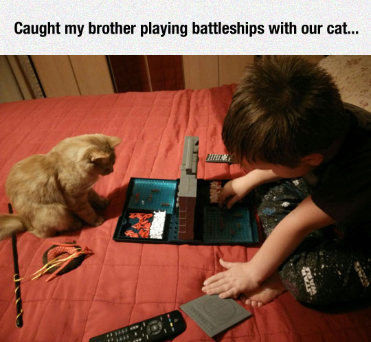 funny-toddler-playing-Battleship-cat-bed