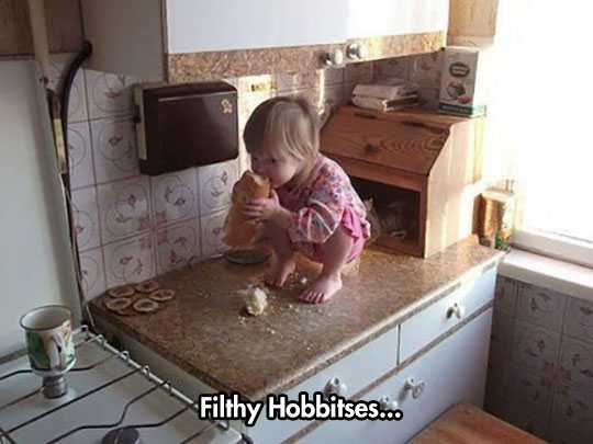 cute-baby-girl-eating-bread-counter