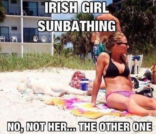 funny-white-girl-sunbathing-sand-beach