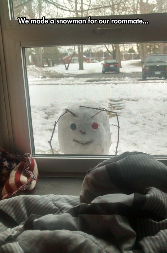 funny-snowman-window-looking-inside