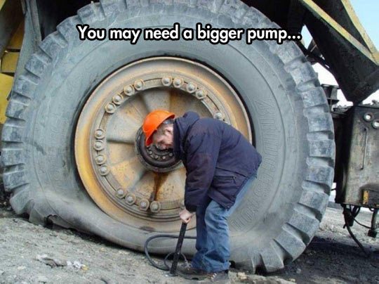funny-worker-giant-tire-wheel-truck