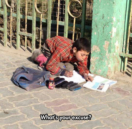 funny-kid-studying-street-books-homework