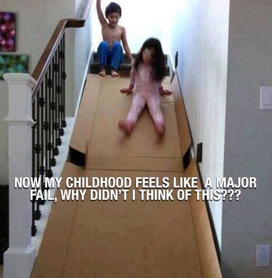 funny-kids-playing-stairs-cardboard-slide
