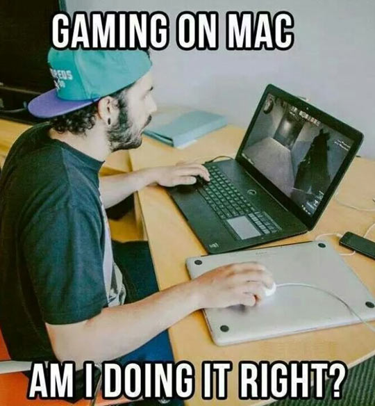 funny-man-playing-games-Mac-pad