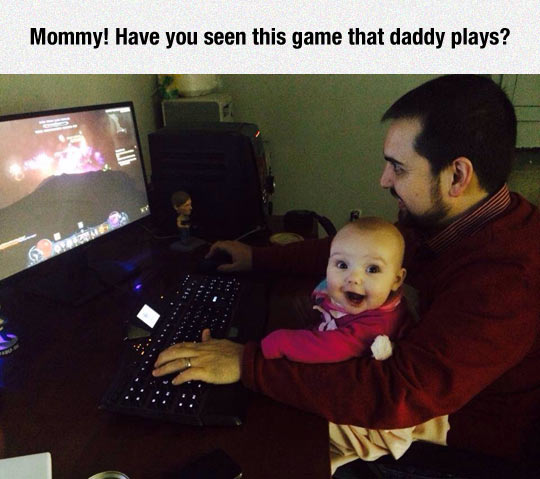 funny-playing-game-computer-baby-happy