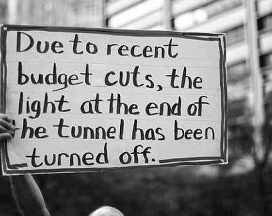 funny-sign-budget-light-end-tunnel