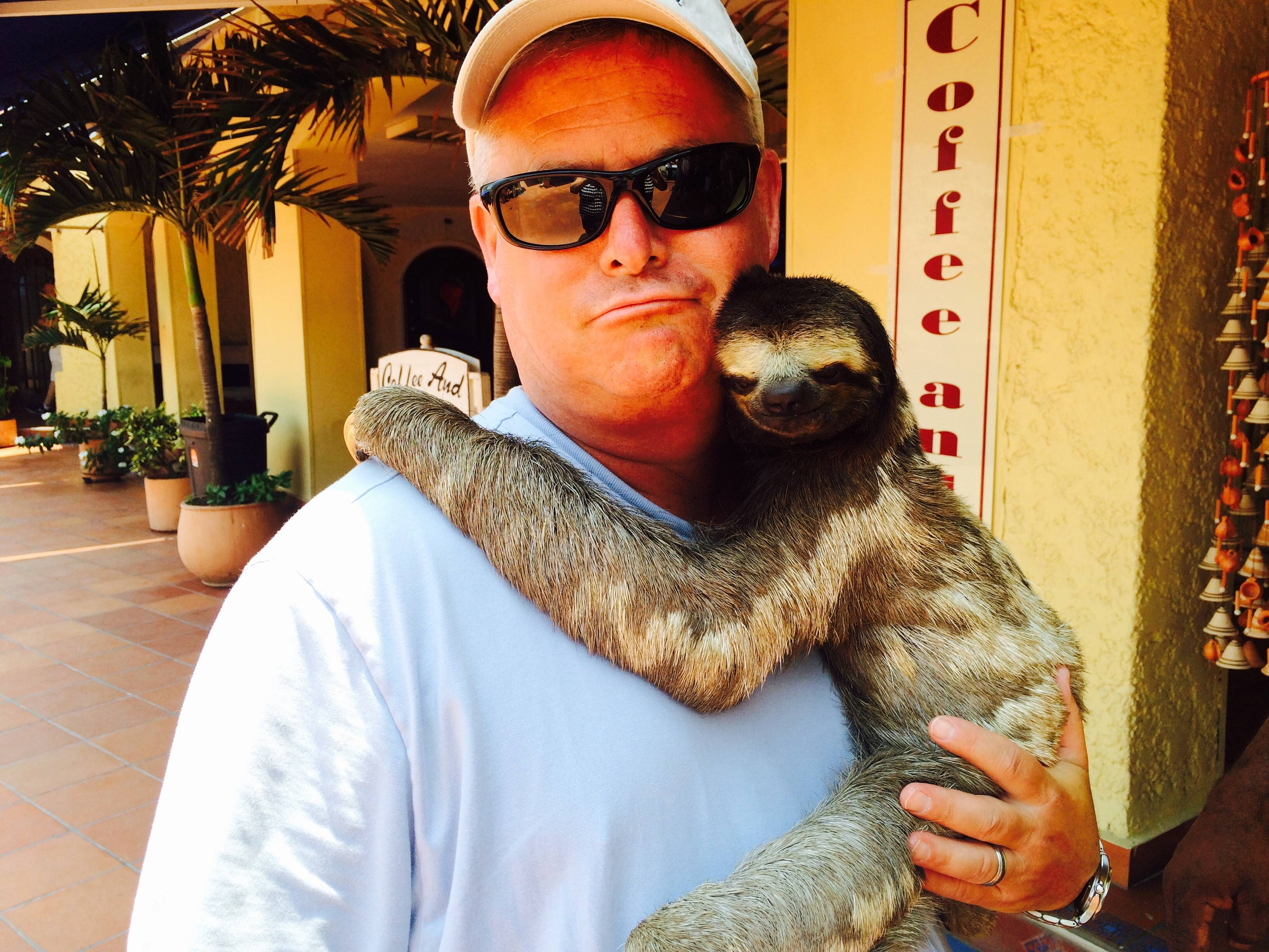 Dad with a sloth. Super jealous.