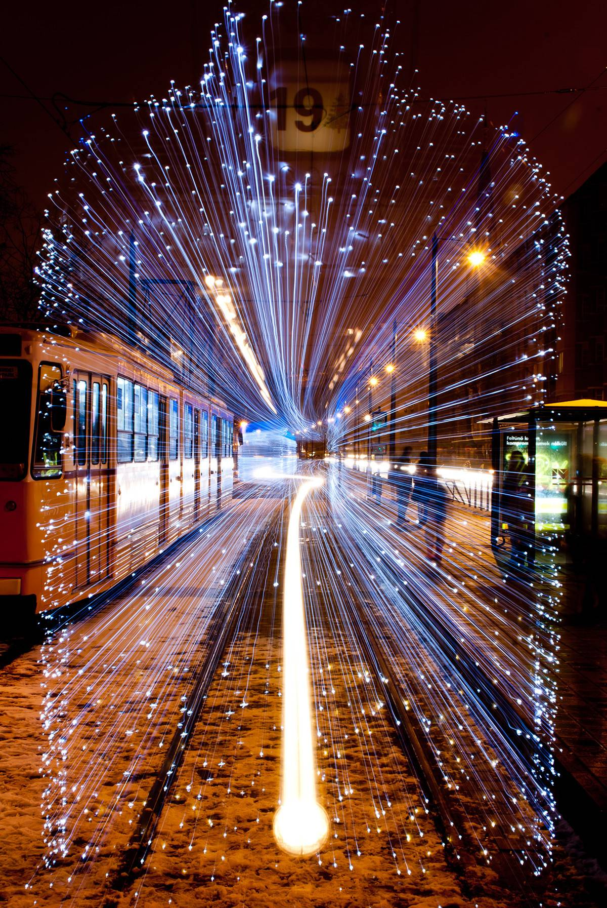 Long exposure of a departing Tram in Budapest covered in 30,000 LED lights