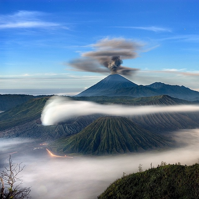 Mount Bromo (foreground) and Mount Semeru, simultaneously erupting in Indonesia