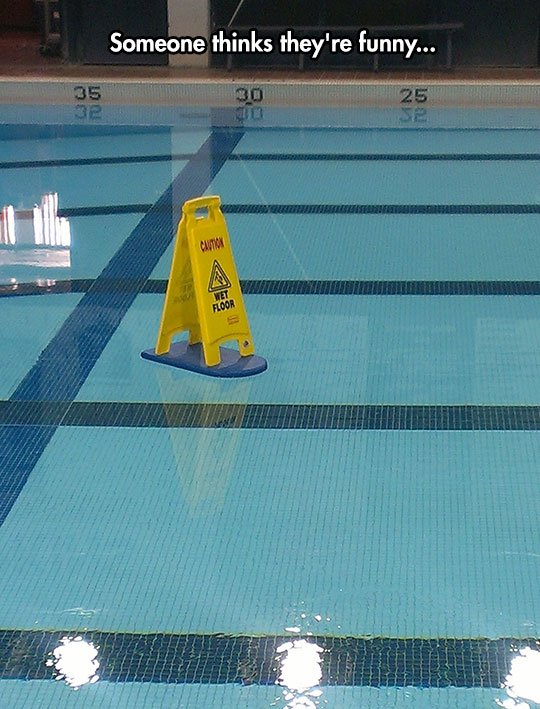 funny-wet-sign-pool-floating