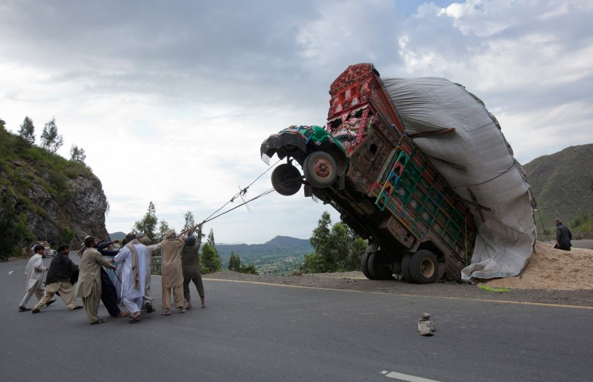here we see a group of pakistani hunters trying to demosticate a wild truck