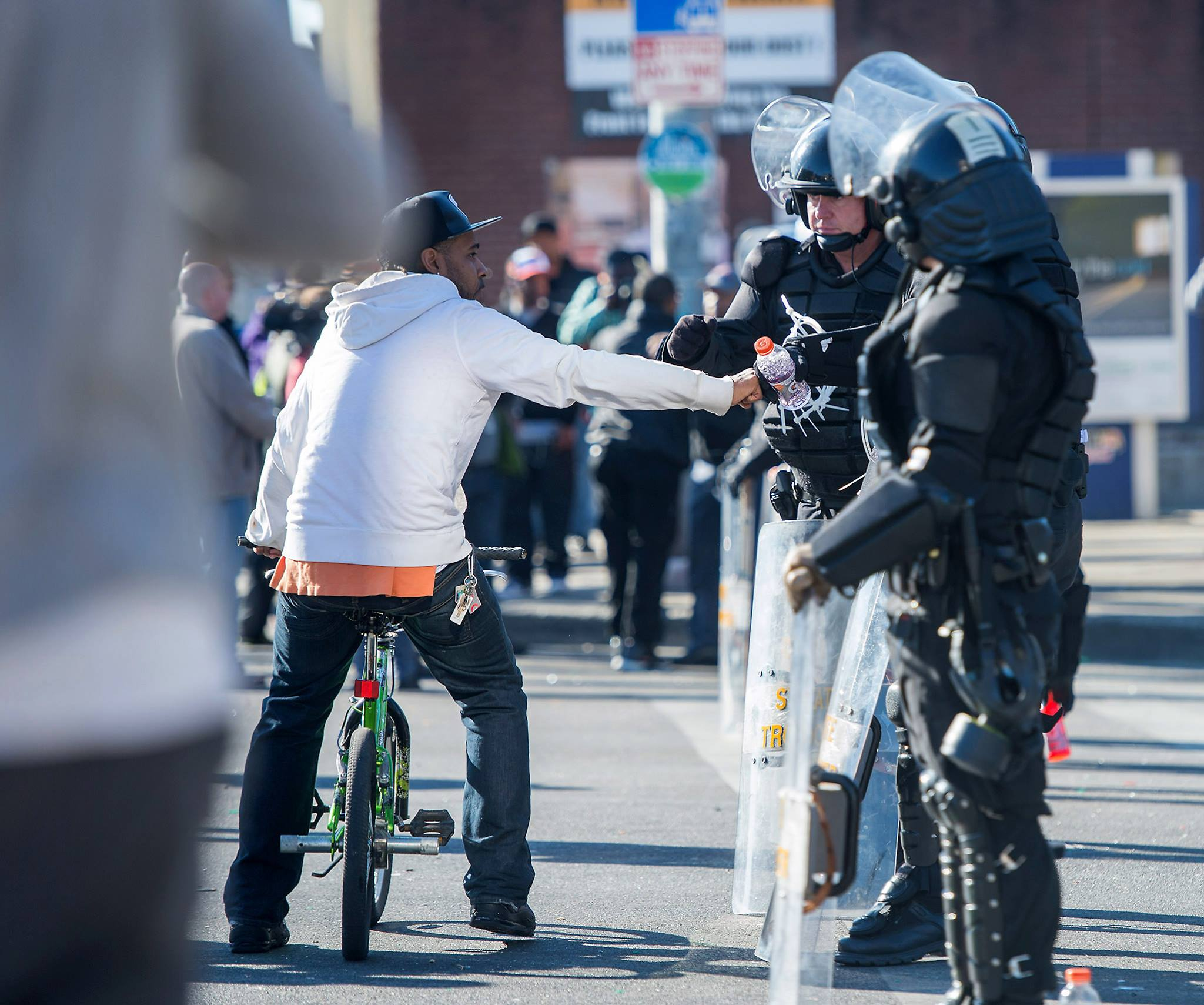 a young man giving Baltimore PD a fist bump