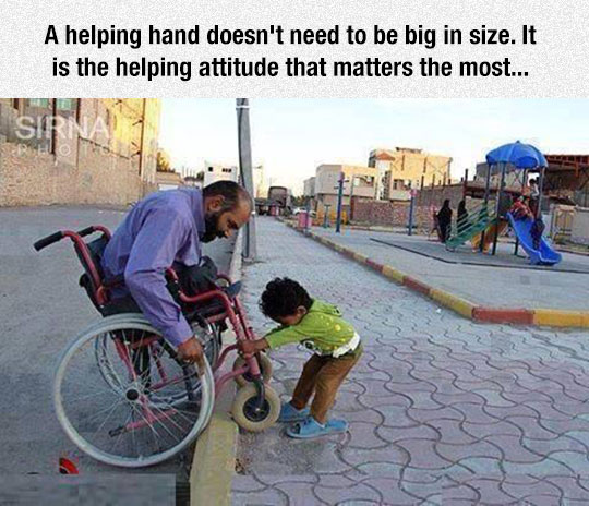 cute-kid-helping-wheelchair-street