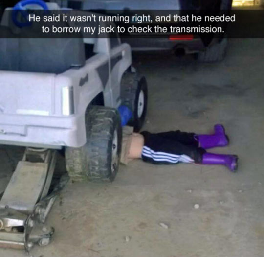 funny-kid-playing-car-toy-check