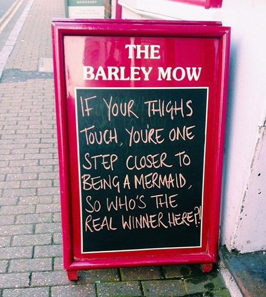 funny-restaurant-sign-thighs-mermaid