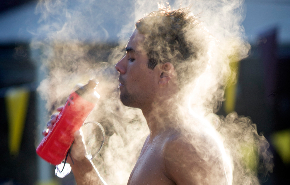 Steam rises from Arizona State University swimmer after team practice
