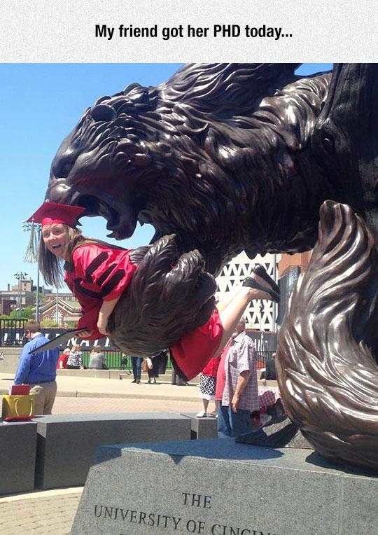 cool-graduate-statue-eating-girl