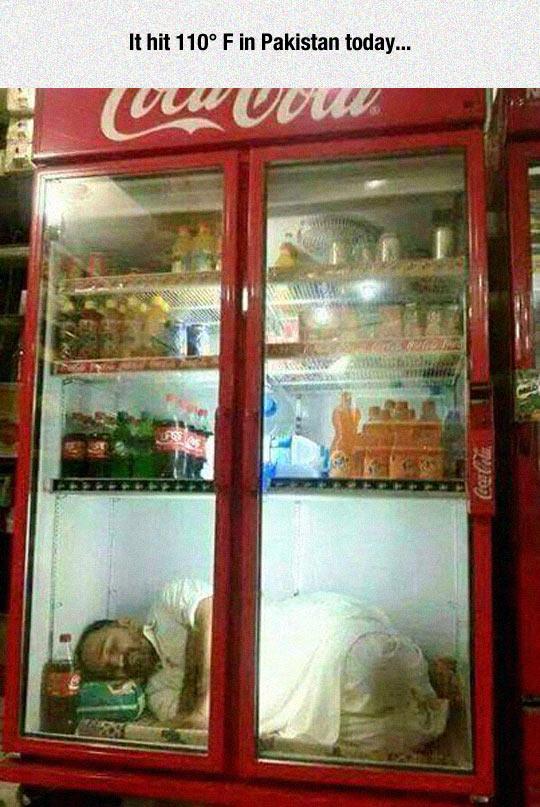 funny-man-sleeping-fridge-Pakistan