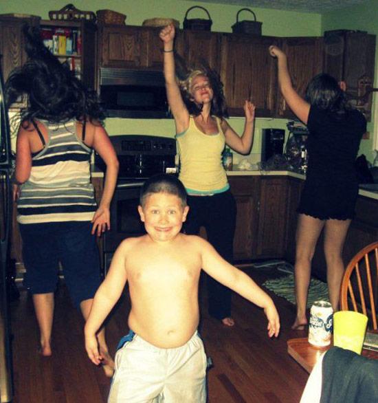 girls-dancing-kitchen-young-shirtless-chubby-boy-smiling-camera