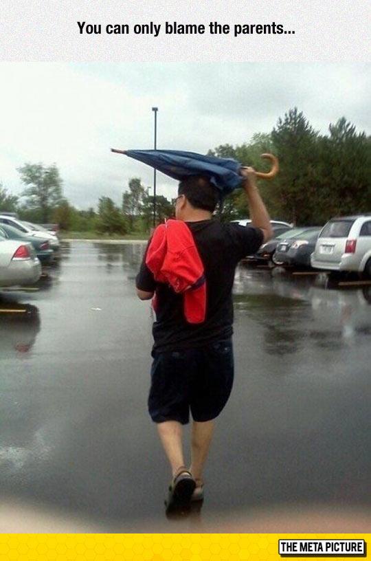 funny-man-umbrella-raining-parking