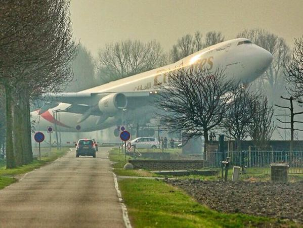 Incredible picture of an Emirates Boeing 747 taking off from Schiphol airport